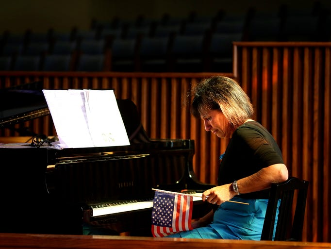 Director of Middletown United Methodist Preschool Debbie Arbach sits at a piano before a end of the year performance. May 23, 2014