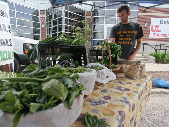 Mike Mayberry at his booth during the U of L Farmer's Market on the Belknap campus in Louisville, KY. June 5, 2014