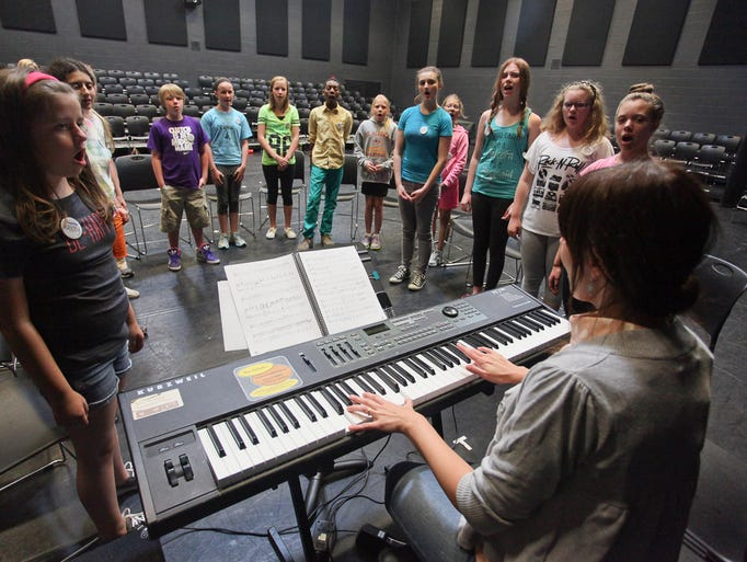 Amanda Clark, music director, works on vocal lessons during StageOne DramaWorks Summer Camp at Lincoln Performing Arts School in Louisville, KY. June 16, 2014