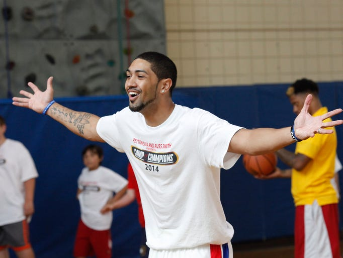 Former University of Louisville basketball player Peyton Siva jokes with campers during the second day of the first annual Kentucky Camp of Champions hosted by Siva, who now plays for the Detroit Pistons, and former U of L teammate Russ Smith, who is up for the 2014 NBA draft. Held at Louisville Collegiate School, the three day camp helps children ages 6 through 16 develop their basketball skills.   June 17, 2014