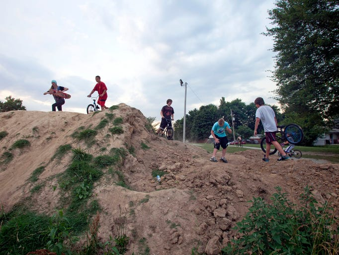 Hillview and Mount Washington have both raised enough money for skate parks and plan to start construction on them this fall. Until then Bullitt County kids ride wherever they can. (left to right) Zaq Wilcher(sq), Alex Springer, Matt Thomas, Andrew Walters, and Cody Montgomery ride and perform tricks atop a mound of dirt located behind the Hillview Government Center.