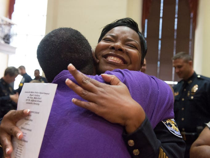 Lavita Chavous hugs her godsister Donna Adams after being promoted to Major at the Louisville Metro Police Department promotion ceremony in Mayor's Gallery. July 1, 2014.