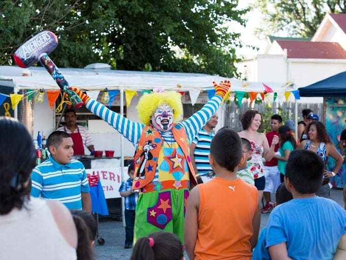 The clown Payosito Koy Koy  entertains children and adults at the Fourth of July Latino Festival in downtown Louisville.  The festival was held to benefit the 10th Annual Backpack Angel Program.