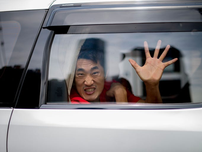 HONG KONG - AUGUST 19:  Dong Hyun Kim on a Uber Taxi to a UFC workout session at Wing Chun Gym in Tsim Sha Tsui on August 19, 2014 in Hong Kong.  (Photo by Anthony Kwan/Getty Images)