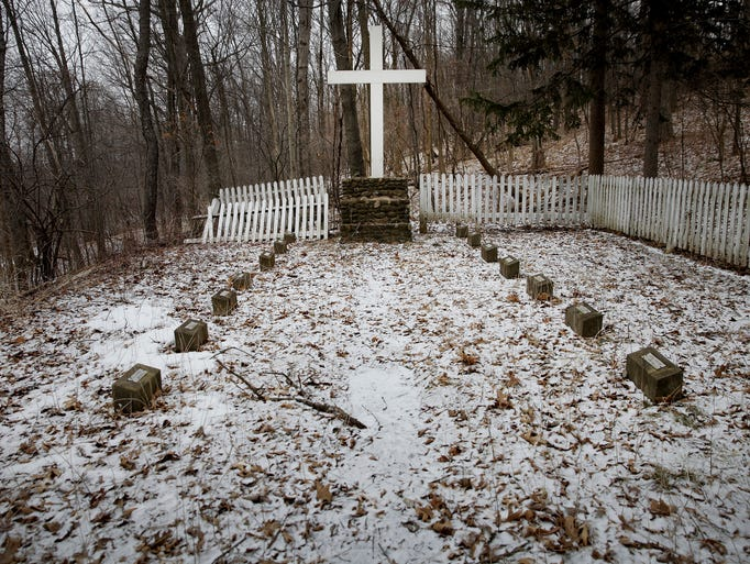 The snow-covered Industry Residential Center graveyard in Rush.The bodies of 14 boys are buried here from the early 20th century. The land has been privately owned for years and no one is responsible for its upkeep.