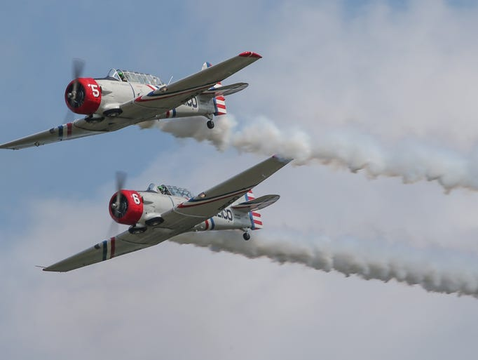 The Geico Skytypers Airshow Team in the airshow and a demonstration ride at AirVenture 2014. The team uses vintage AT-6 aircraft to perform precision aerobatic maneuvers, as well as type messages in smoke in the sky.