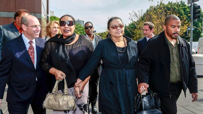 Attorney Richard Busch, far left, walks with late singer Marvin Gaye's family members, from left, daughter, Nona Gaye, ex-wife, Jan Gaye, and son, Frankie Gaye, outside the Los Angeles U.S. District Court on March 10, 2015.