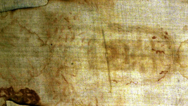 In this Aug. 12, 2000 file photo, The Holy Shroud, a 14 foot-long linen revered by some as the burial cloth of Jesus, is shown at the Cathedral of Turin, Italy.