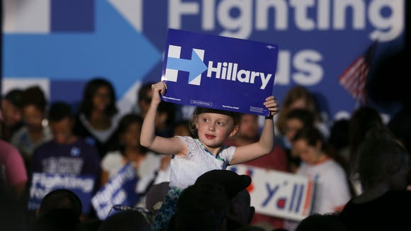 A young Hillary Clinton supporter looked for cameras before a rally at Slugger Field.May 10, 2016