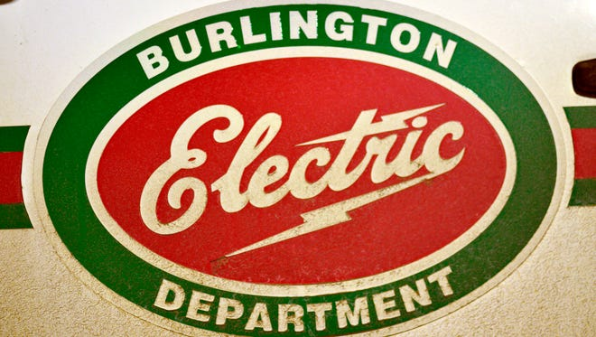 The logo for the city-owned Burlington (Vt.) Electric Department is seen Dec. 30, 2016, on a truck in the utility's parking log.