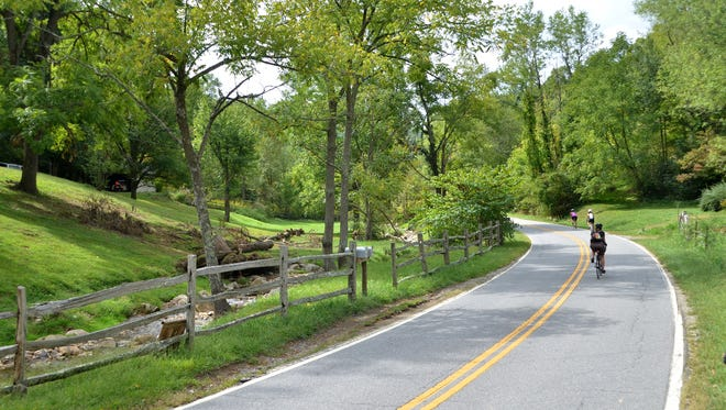 Riders enjoy a short downhill stretch after visiting East Fork Farm.