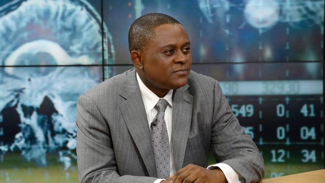 Dr. Bennet Omalu, a forensic pathologist whose research linked brain damage to concussions suffered by professional football players, appears on ABC's Good Morning America on Dec. 14, 2015.