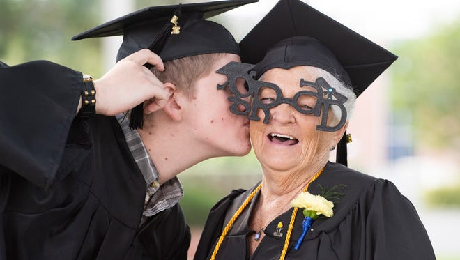 Joseph White congratulates his grandmother, Barbara Gaal, after the IRSC Adult Education Graduation Ceremony in Fort Pierce. Both received general equivalency diplomas and shared an unforgettable day.