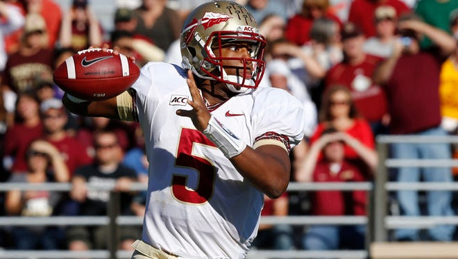 Florida State Seminoles quarterback Jameis Winston throws the ball against the Boston College Eagles during the first half at Alumni Stadium.