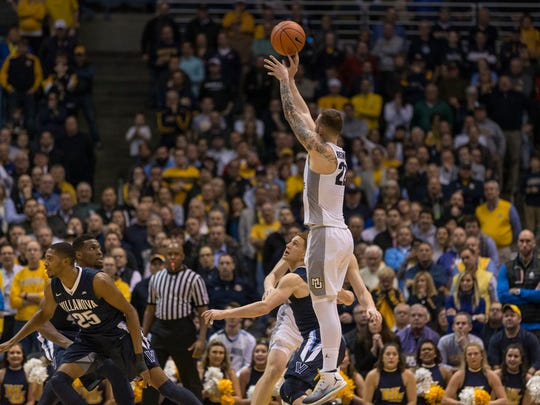 Marquette's Katin Reinhardt ties the game late against Villanova with a three-pointer. Reinhardt hit 4 of 7 three-point shots Tuesday night and scored 18 of his 19 points in the second half of the Golden Eagles' upset victory.