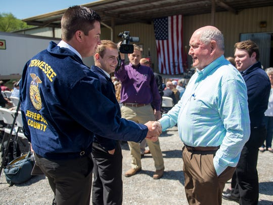 U. S. Department of Agriculture Secretary Sonny Perdue, right, shakes hands with members of Future Farmers of America before speaking at a Tax Day event held at the Knox Farmers Cooperative on Tuesday, April 17, 2018.