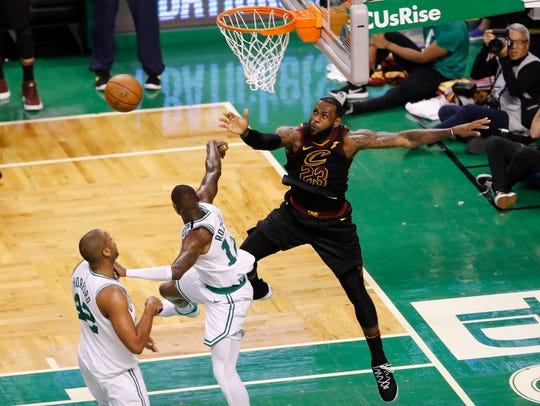 Cleveland Cavaliers forward LeBron James (23) blocks