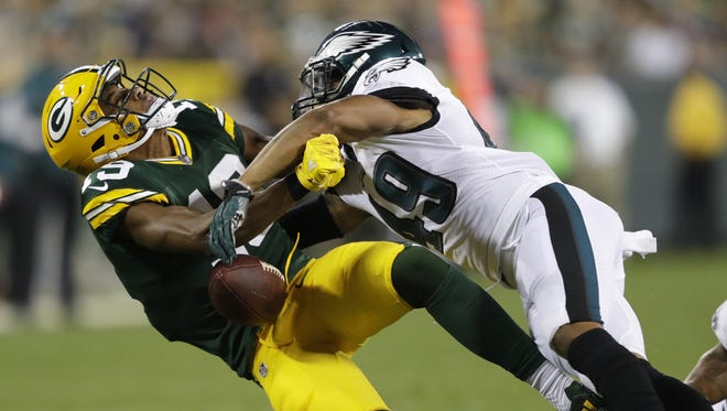 Green Bay Packers' Malachi Dupre drops the ball as he is hit hard by Philadelphia Eagles' Tre Sullivan in the second half Thursday, August 10, 2017, at Lambeau Field in Green Bay, Wis. Dupre was carted off the field.
