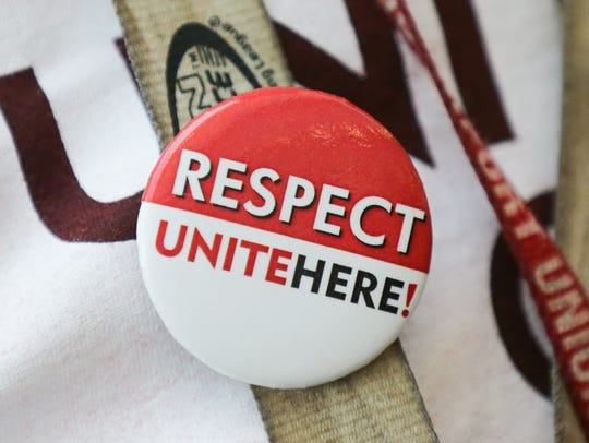Benjamin Calbert wears a union button at Indianapolis International Airport.