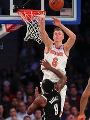 New York Knicks forward Kristaps Porzingis (6) blocks a shot by Brooklyn Nets forward DeMarre Carroll (9) during the first quarter of an NBA basketball game, Friday, Oct. 27, 2017, in New York. (AP Photo/Julie Jacobson)