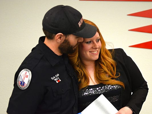 Felicia Hill thanks REMSA paramedic Kyle Cobb for his efforts to save her baby