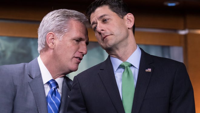 "House Majority Leader Kevin McCarthy, R-Calif., and Speaker of the House Paul Ryan, R-Wis., confer during a news conference following a closed-door GOP meeting on immigration, on Capitol Hill in Washington, Wednesday, June 13, 2018. Ryan says compromise legislation is in the works on immigration that has an ""actual chance at making law and solving this problem."""