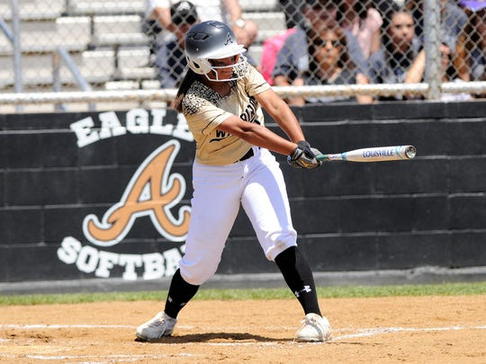Abilene High's Jaiden Franklin (5) hits an RBI double in the Lady Eagles' seven-run second inning during the Lady Eagles' 12-1, five-inning win against Fort Worth Paschal in Game 1 of the bi-district playoffs.