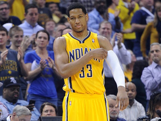 Fans in the background clap as Danny Granger waits to enter the game for the first time in the first quarter. The Pacers hosted the Houston Rockets in NBA action Friday December 20, 2013 at Bankers Life Fieldhouse.