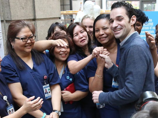 Dr. Craig Spencer poses with Bellevue Hospital staff members after he was declared free of the Ebola virus in New York, New York, USA 11 November 2014. Reports state that Craig Spencer, who was the last known person in the USA to have contracted Ebola whilst working for Medecins Sans Frontieres in Guinea, has recovered and 'has been declared free of the virus', according to officials. EPA/ANDREW GOMBERT