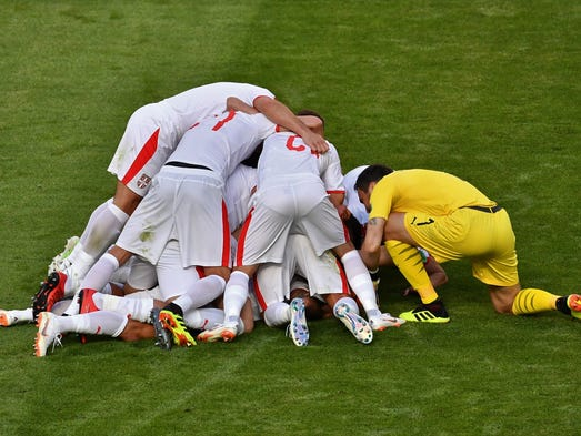 Serbia's players celebrate their opening goal against