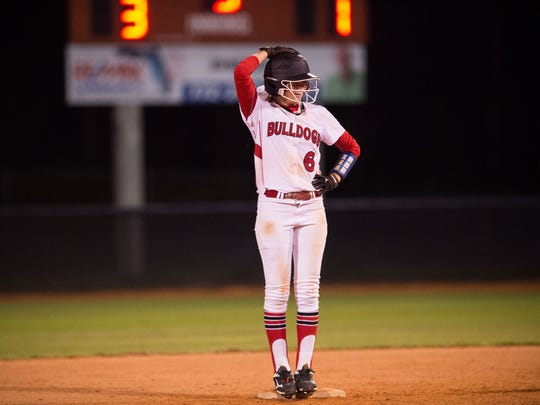 South Fork's Sam Williams smiles to the dugout after