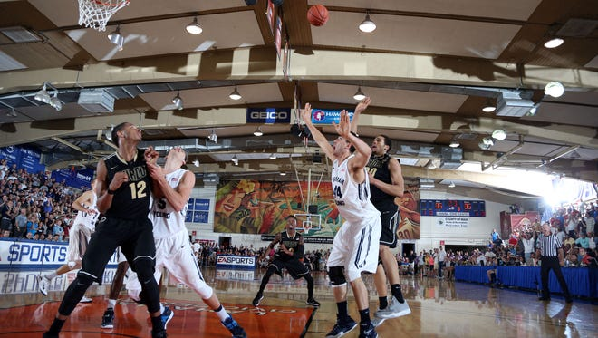 Nov 26, 2014; Lahaina, Maui, HI, USA; Purdue Boilermakers center A.J. Hammons (20) makes the winning shot with one second to go in the game against Brigham Young Cougars center Corbin Kaufusi (44) during the 2014 EA Sports Maui Invitational at the Lahaina Civic Center. Purdue defeats Brigham Young 87-85 in overtime. Mandatory Credit: Brian Spurlock-USA TODAY Sports