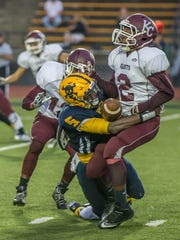 Battle Creek Central's Brandon Randle, who is among the new MSU recruits, causes a fumble during a game last fall.