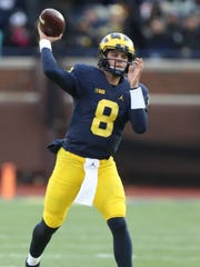 University of Michigan Wolverine's John O'Korn looks to pass against the Indiana Hoosier's during first half action Saturday, November 19, 2016 at Michigan Stadium in Ann Arbor MI.  Kirthmon F. Dozier/Detroit Free Press
