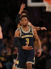 Michigan guard Zavier Simpson walks to the bench during second half action against Nebraska Friday, March 2, 2018 at Madison Square Garden in New York.