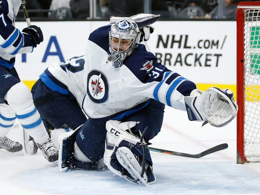 FILE - In this April 9, 2016, file photo,  Winnipeg Jets goalie Ondrej Pavelec moves to make a save against the Los Angeles Kings during the second period of an NHL hockey game in Los Angeles. A person with direct knowledge of the deal says the New York Rangers have signed Pavelec to a one-year deal worth $1.3 million. The person spoke to The Associated Press on condition of anonymity Saturday, July 1, 2017, because the contract had not been announced. (AP Photo/Danny Moloshok, File)