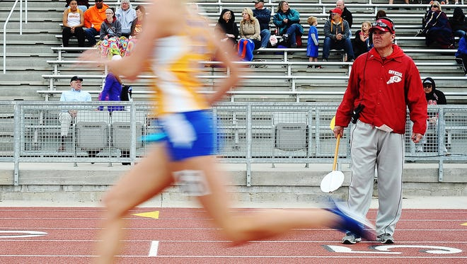 Volunteer, Randy Marso, looks on during the women's 4x400-meter relay during the Dakota Relays on Saturday, May 3, 2014, at Howard Wood Field in Sioux Falls. (Joe Ahlquist / Argus Leader)
