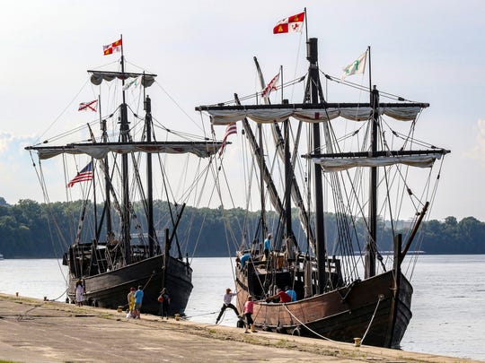 Crews with the Columbus Foundation work to dock replicas of the Christopher Columbus ships, Nina, right, and Pinta, in Owensboro, Ky, at English Park.
