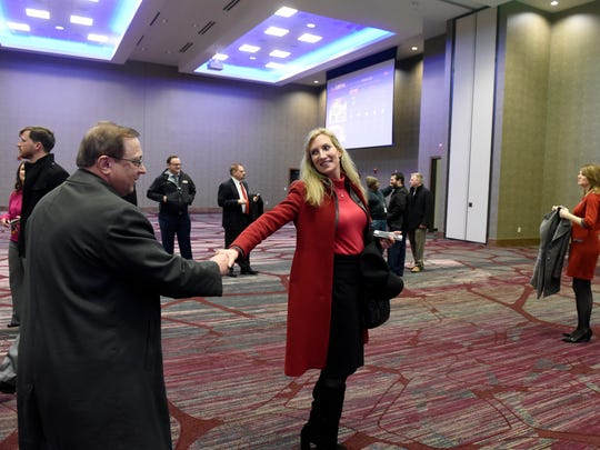 Russ Lloyd Jr., shakes hands with Christy Gillenwater in the ballroom of the new 241-room, five-floor Hilton DoubleTree hotel after its official opening in Downtown EvansvilleÊTuesday, Feb., 14, 2017.