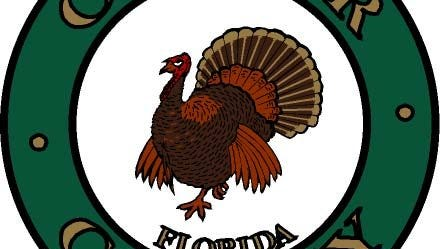 Native to the region, the wild turkey was adopted as Collier County's emblem by the Board of County Commissioners at their first meeting held on July 7, 1923.  When the county seat was relocated to East Naples in 1962, the emblem was incorporated into the County seal that was designed by Margaret T. Scott.  Scott was Clerk of Courts from 1959 until 1976.