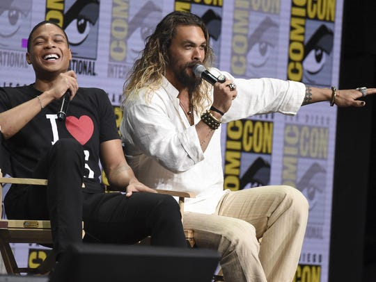 Jason Momoa, right, speaks as Ray Fisher reacts.