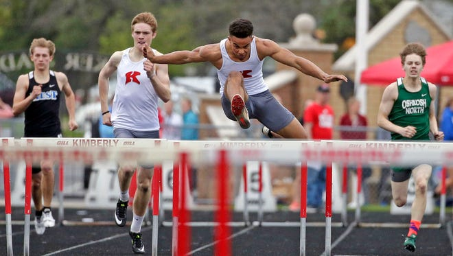 DJ Stewart of Kimberly wins the 300 Meter Hurdles as the Fox Valley Association track and field conference championships take place Monday, May 14, 2018, in Kimberly, Wis.