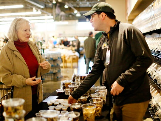 Sharon Johnson, of Red Lion, left, tries a sample while