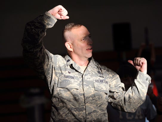 "Lt. Col. Mike Fanton, commander of the 7th Force Support Squadron, Zumba-dances to ""Cotton-eyed Joe"" with children and the Dallas Cowboys Cheerleaders Friday at Dyess Air Force Base."