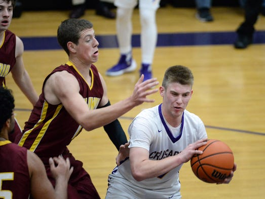 Lancaster Catholic's Chad Wenger turns to make a pass