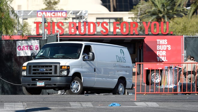 A funeral home van departs the Las Vegas Village concert grounds on Oct. 2, 2017 in Las Vegas.