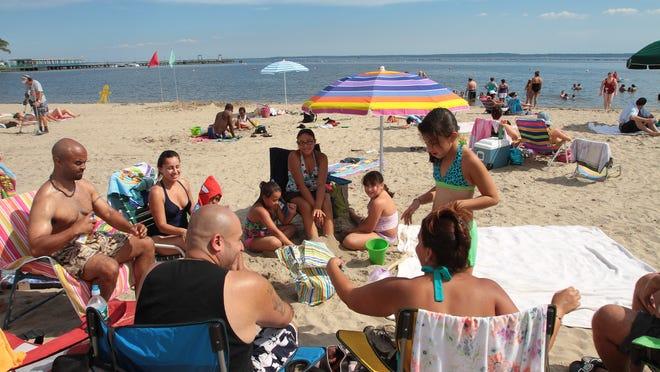Beachgoers enjoy Playland Beach in Rye. Westchester beaches open for the season May 23.