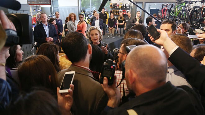 Hillary Clinton agreed to an impromptu news conference after a reporter called out to her from behind a security rope line in Cedar Falls, Iowa, on Tuesday, May 19, 2015.