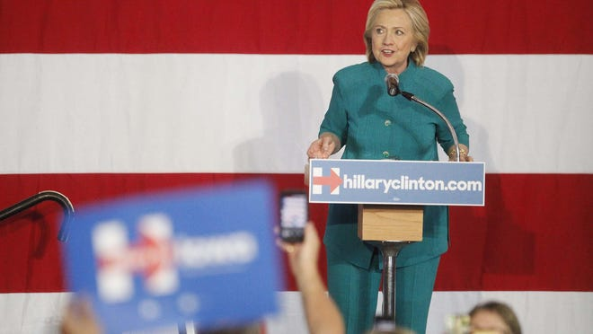 Hillary Clinton addresses the crowd Sunday at the Iowa State Fairgrounds, in her first public rally in Iowa of the 2016 cycle.