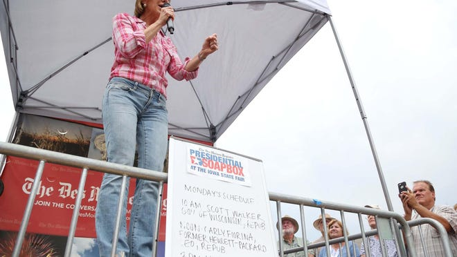 GOP presidential hopeful Carly Fiorina speaks at The Des Moines Register Political Soapbox on Monday at the Iowa State Fair.